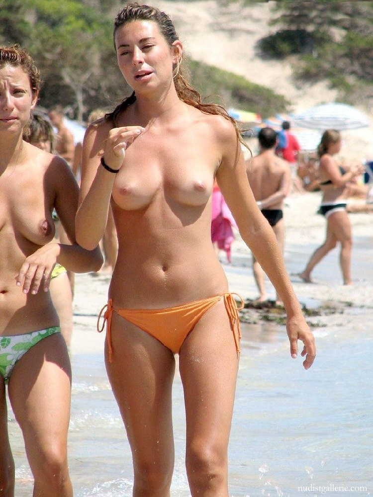 Picturea of topless women on beach