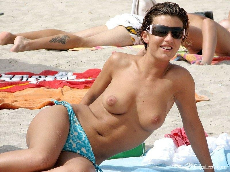 Picturea of topless women on beach are mistaken