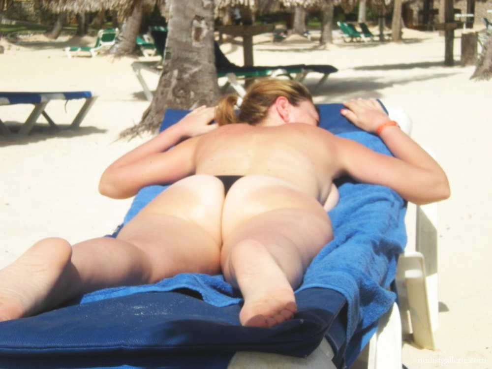 Topless women on holiday