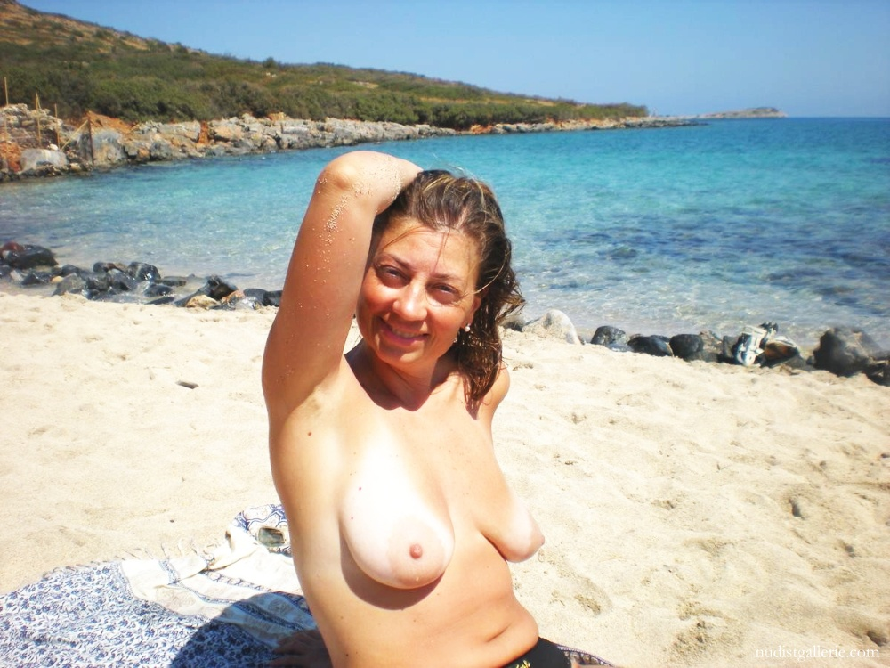Picturea of topless women on beach agree