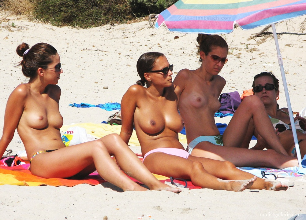 Topless girls on the beach, mature defense mechanism